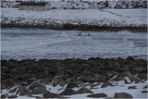 Surfer am Unstad Beach